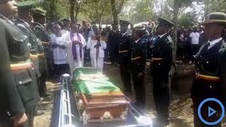 Prison warders honor slain beauty queen Pauline Wangari with a 21 gun salute during her burial