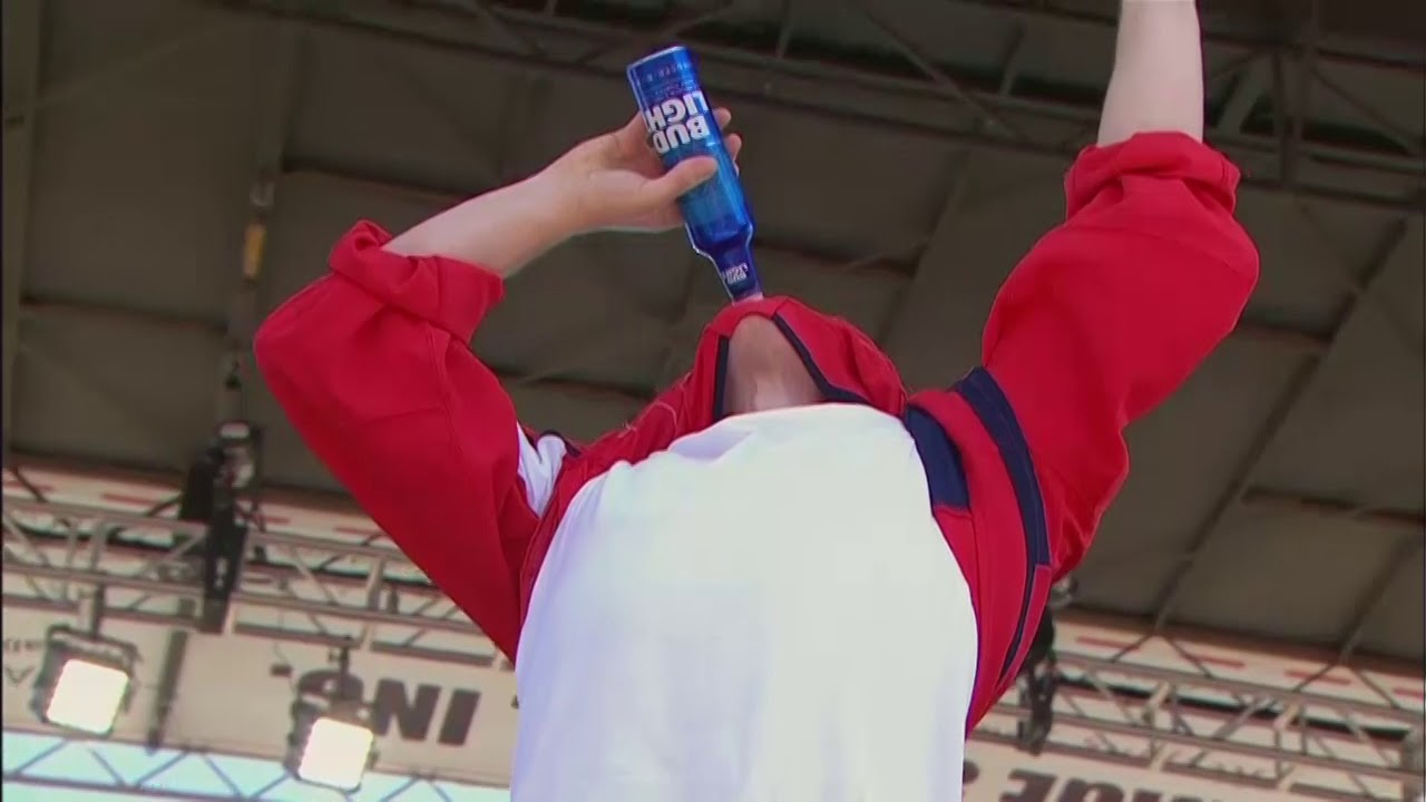 great fit 3d977 9ca2e Washington Capitals' T.J. Oshie chugs a beer through his jersey at Stanley  Cup rally