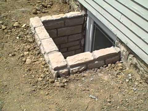 Custom Stone Egress Window Wells - YouTube
