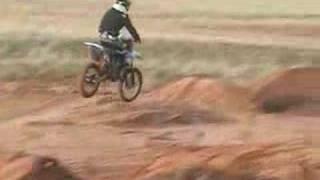Derek Ledbetter and Craig Thomas riding motorcycles fast