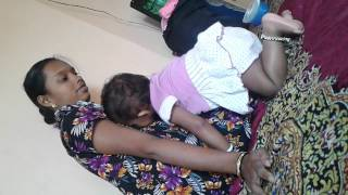Mridula drinking her mother milk