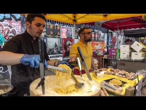 Italian Soft Fresh Spaghetti Savoured In A Cheese Wheel. London Street Food