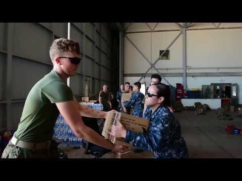 Sailors And Marines Unload Water, Food At NAS Key West
