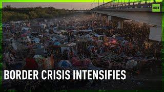 Thousands of migrants filmed under Texas bridge as border crisis intensifies