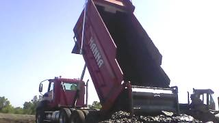 dump truck full of water and mud