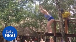 Woman's zip-line attempt ends in failure - Daily Mail