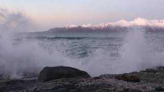 Relaxing waves chrashing onto a beach in  Kjerringoy Nothern Norway on an arctic winter day.