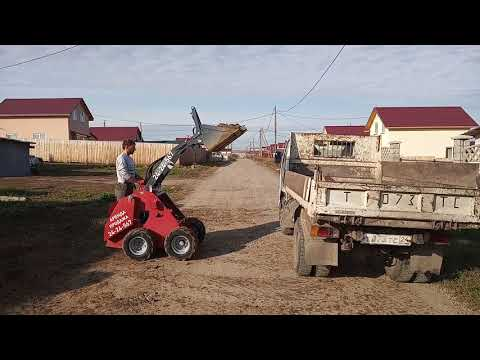 Загрузка глины в грузовик (Helffer). АРЕНДА, ПРОДАЖА мини-погрузчиков HELFFER  т. 8-902-990-4567