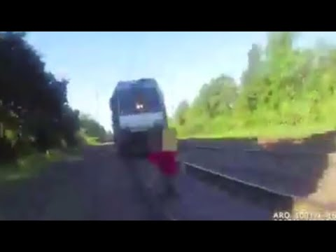 Video: Cop shouts, saves man from oncoming train