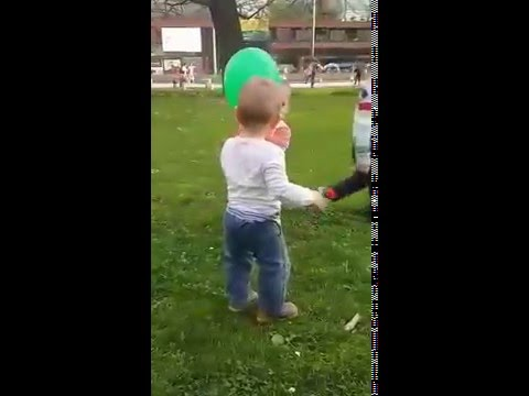 SO CUTE Girl stealing balloon from a boy in park