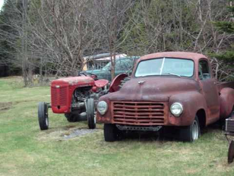 old cars and trucks saved from crusher rust in peace in the woods