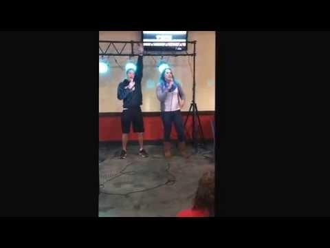 Taylor Schwartz and Luke Denman sing karaoke