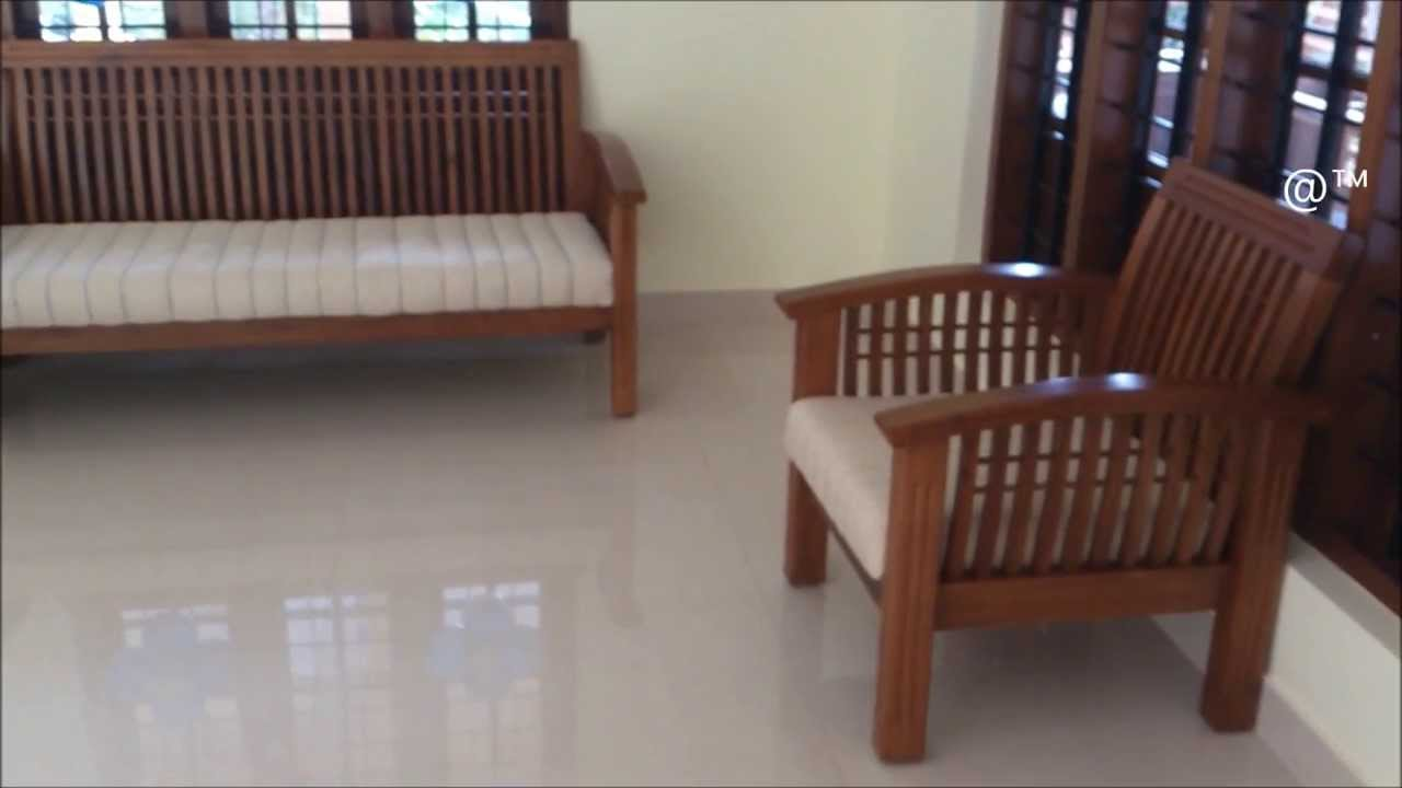 Kerala Style Wooden Sofa Set Designs