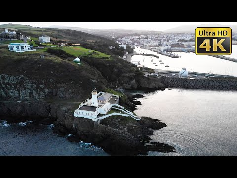 Douglas Head Lighthouse and Tower of Refuge, Douglas Harbour Isle of Man - 4K Aerial Stock Footage