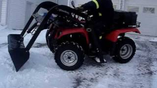 Repeat youtube video ATV quad loader in action snow removal
