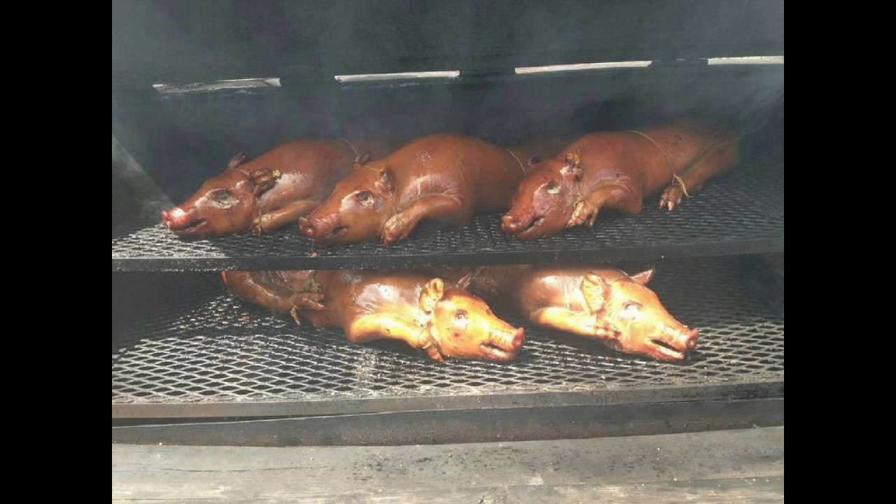 BQ Smokers pig cooker smokers and barbecue pits - YouTube