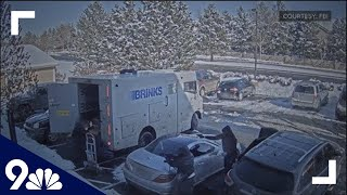 RAW | Suspects caught on video robbing armored vehicle with AK-47 and handguns