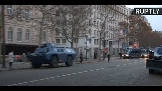 Armored vehicles in central Paris as France braces for another day of protests