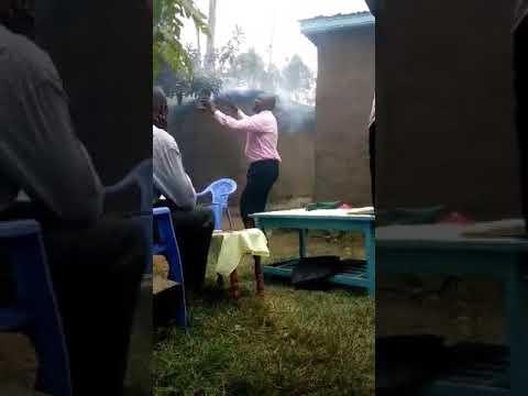Bro Haron Preaching Under Trees in Western Kenya