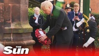 Boris Johnson lays a poppy wreath honouring veterans at Remembrance Day service in Wolverhampton