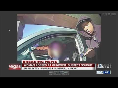 Woman robbed at gunpoint outside bank