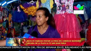 Familias disfrutan de altares en homenaje a la Virgen María y adornos en la Avenida de Bolívar