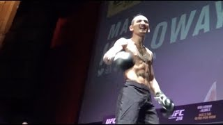 Max Holloway brings fan onto stage at the UFC 218 open workouts