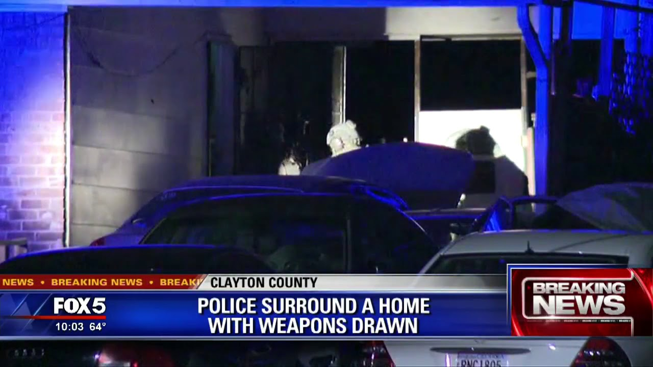 Clayton County Police surround home with weapons drawn
