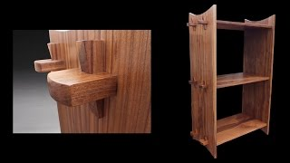 I built this bookshelf using Japanese style joinery. Through tenon with a wedge. It is made from walnut and finished with a satin poly
