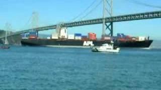 SF Bay Cargo Ship Cruise Under Bridge