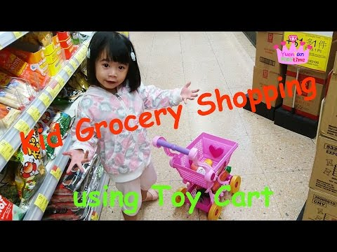Kid Grocery Shopping using Toy Cart