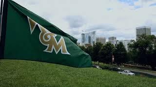 William & Mary Athletics Flag against the Richmond Skyline