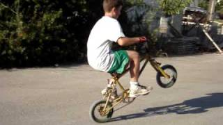 Doing wheelies with a small bicycle