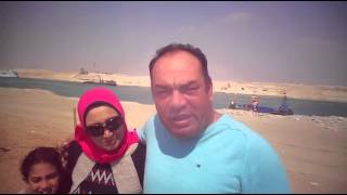 People smell the breeze and celebrate spring in the new Suez Canal, April 13, 2015