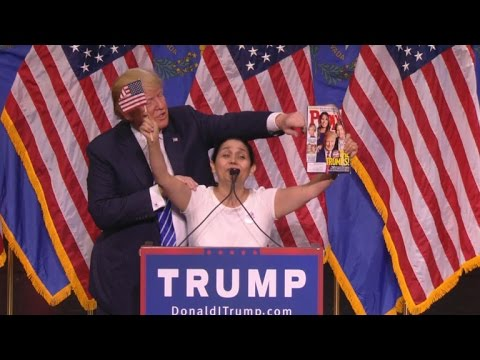 Donald Trump brings up a Colombian voter who proclaims her love and support for MisterTrump. Donald Trumpkisses her and grabs her waist, it is hilarious.