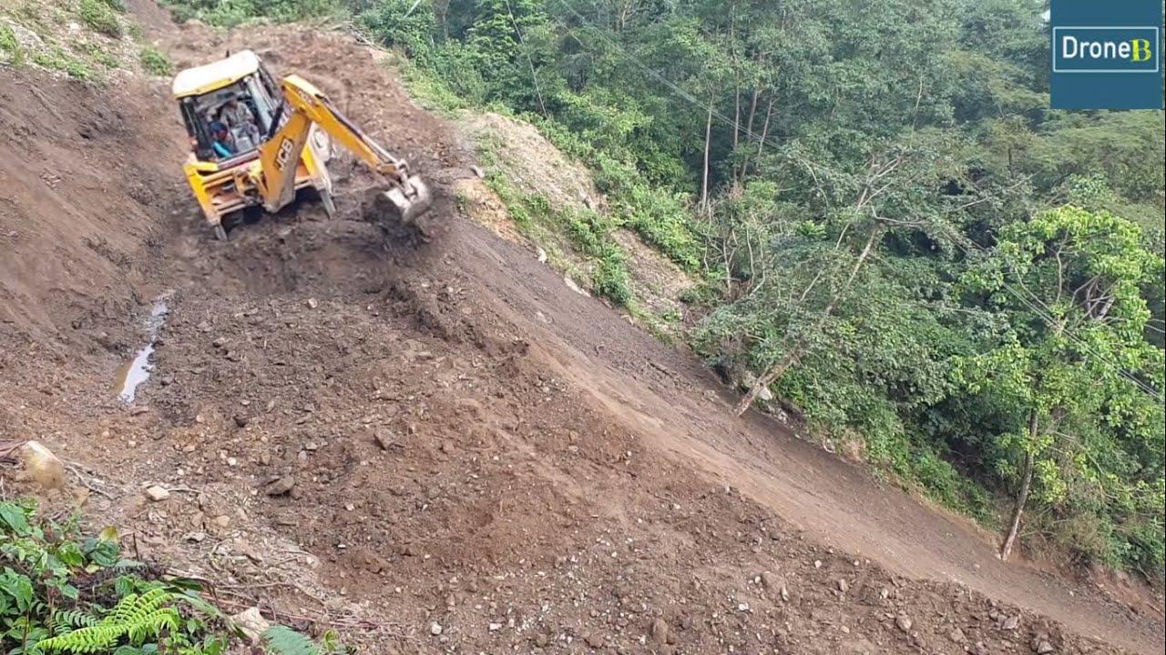Hilly Roadslide-Backhoe Loader-Removing Dirt-Fixing Damaged Hilly Road