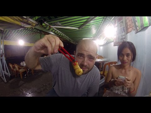 Wanna eat a live larvae coconut worm? Extreme street-food in