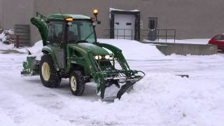 john deere plowing snow