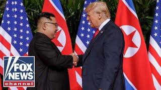 Trump and Kim Jong Un begin summit with groundbreaking handshake