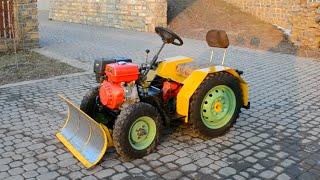 Самодельный трактор для уборки снега Tractor hydraulic(Самодельный трактор для уборки снега работающий от масляного гидропривода. Аппарат имеет мощность 12 л.с..., 2015-02-25T00:10:40.000Z)