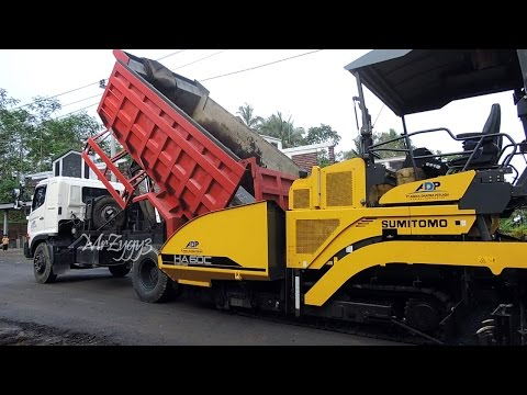 Asphalt Paver Sumitomo HA60C And Dump Truck Working