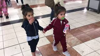 BELLA & VIENNA hold hands In the mall
