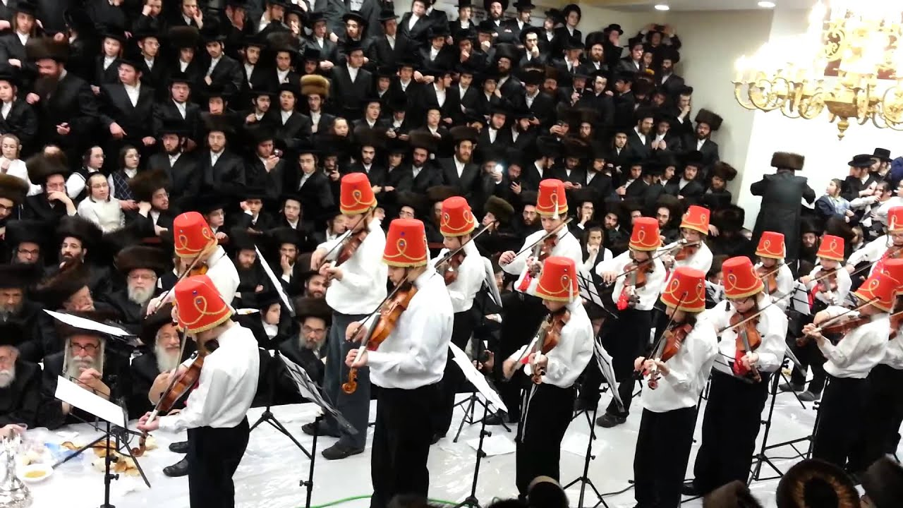 Kids playing violin at Spinka tish Shushan Purim 5774