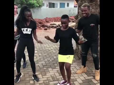 Young Ghana school girl showing off her dancing skills thumbnail