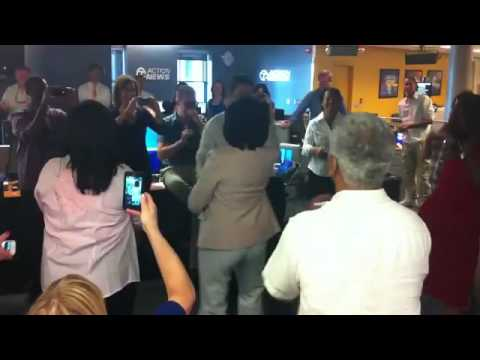 Diana Lewis leads the WXYZ newsroom in dance to Celebration