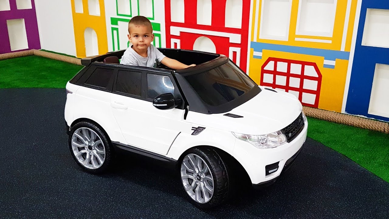 Dima in indoor playground - ride on power wheels car