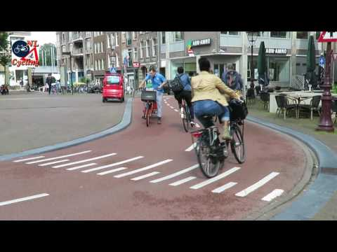Cycling on Haarlemmerplein in Amsterdam