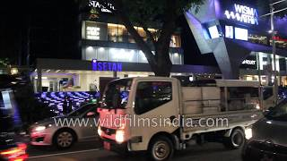 Changi airport arrivals and orchids, Orchard Road drive-through, Singapore