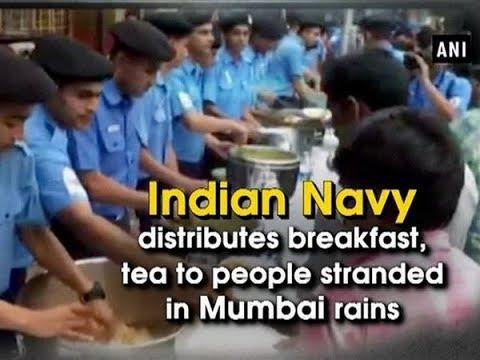 Indian Navy distributes breakfast, tea to people stranded in Mumbai rains - Maharashtra News