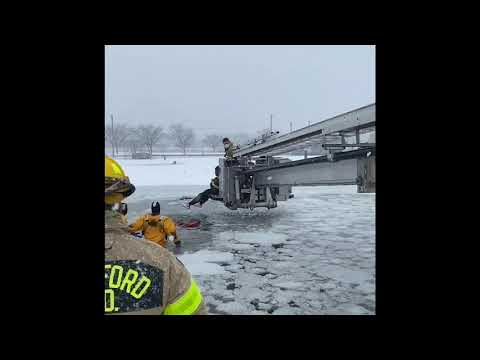 Stamford firefighters rescue two people stranded in a sinking pickup truck during Nor'easter.